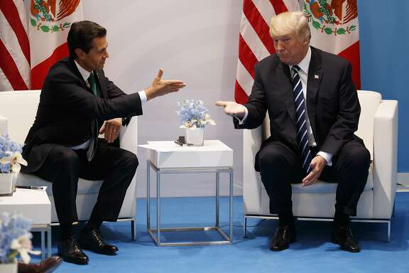 FILE - In this July 7, 2017 file photo, U.S. President Donald Trump meets with Mexican President Enrique Pena Nieto at the G20 Summit, in Hamburg. Trump's push to renegotiate the North American Free Trade Agreement is putting Mexico in a tough spot, threatening the system that has helped turn the country into a top exporter through low wages, lax regulations and proximity to the United States. Talks are set for Aug. 16 in Washington D.C. (AP Photo/Evan Vucci, File)