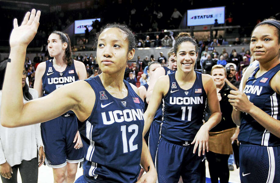 UConn's Saniya Chong (12) and her teammates wave to fans after a win over SMU in January. Photo: The Associated Press File Photo  / FR168019 AP