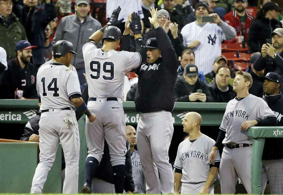New York Yankees' Aaron Judge (99) receives congratulations at the dugout after hitting a two-run home run during the second inning of the team's baseball game against the Boston Red Sox at Fenway Park, Wednesday in Boston. Photo: Elise Amendola — The Associated Press  / Copyright 2017 The Associated Press. All rights reserved.