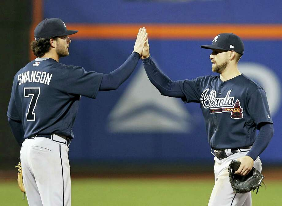 Atlanta Braves second baseman Jace Peterson, right, and shortstop Dansby Swanson celebrate after the Braves defeated the New York Mets 8-2 in a baseball game, Wednesday in New York. Photo: Kathy Willens — The Associated Press  / Copyright 2017 The Associated Press. All rights reserved.