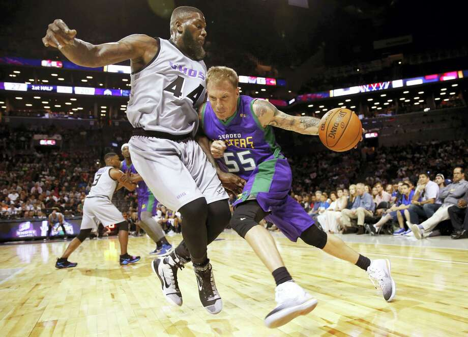 3 Headed Monsters Jason Williams (55) drives up against Ghost Ballers Ivan Johnson (44) during the first half of Game 1 in the BIG3 Basketball League debut on June 25, 2017 at the Barclays Center in New York. Photo: AP Photo — Kathy Willens  / Copyright 2017 The Associated Press. All rights reserved.