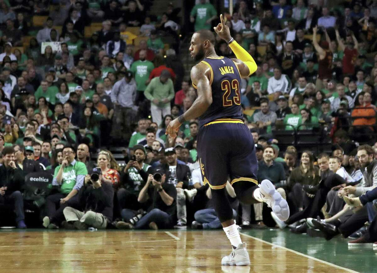 LeBron James celebrates after sinking a 3-pointer in the Eastern Conference finals.