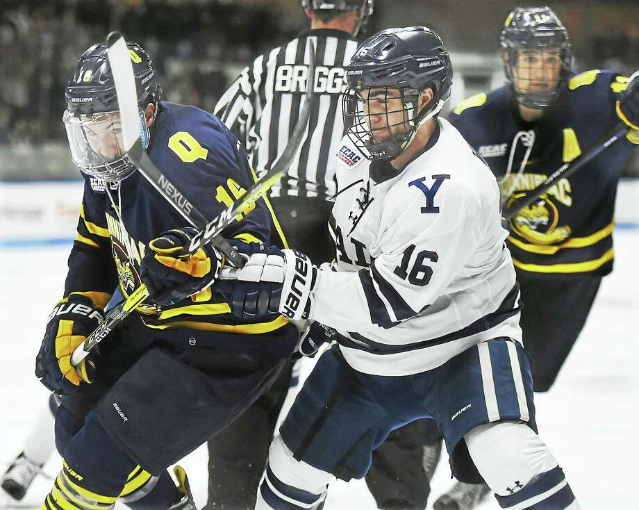 Quinnipiac's Landon Smith battles with Yale's Anthony Walsh during their game earlier this month. Photo: Catherine Avalone — Register File Photo  / Catherine Avalone/New Haven Register