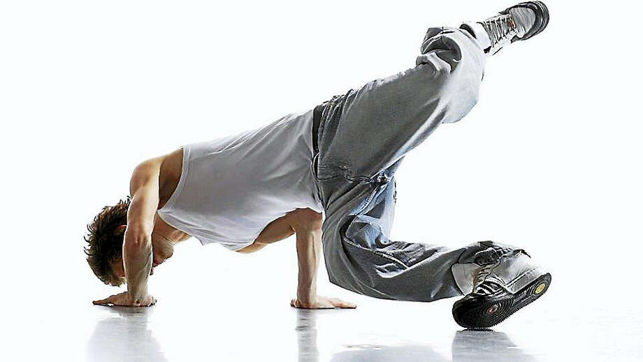 A breakdancer, or b-boy, demonstrates a shoulder stand. Photo: Contributed Photo