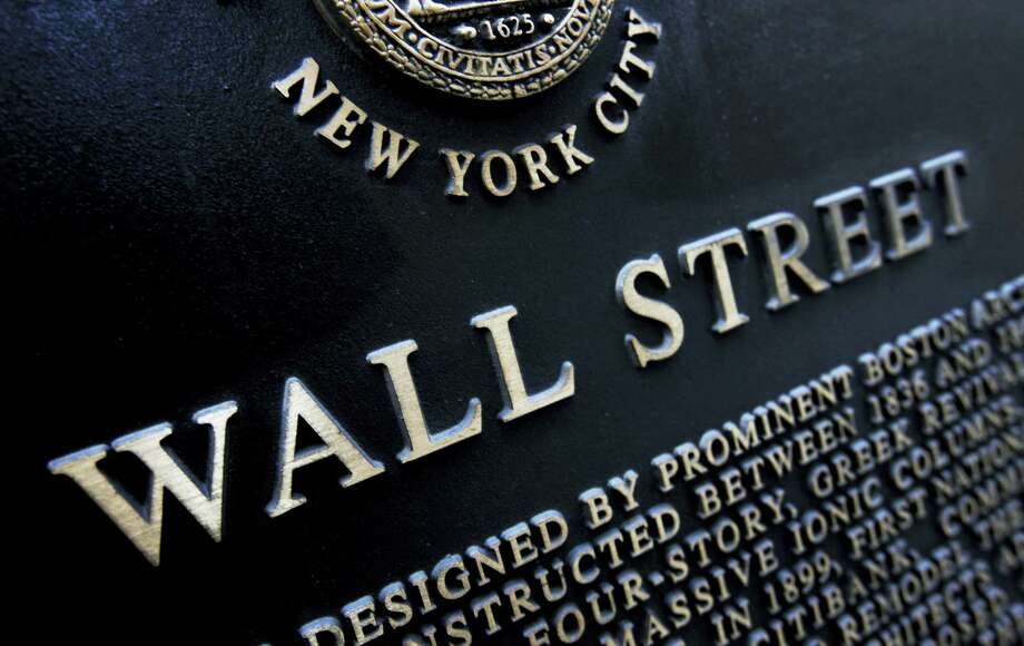 FILE - This Jan. 4, 2010, file photo shows an historic marker on Wall Street in New York. On Thursday, April 27, 2017, global stocks were subdued as investors assessed the scant details of President Donald Trump's U.S. tax overhaul. Photo: Mark Lennihan — The Associated Press File  / Copyright 2016 The Associated Press. All rights reserved. This material may not be published, broadcast, rewritten or redistribu