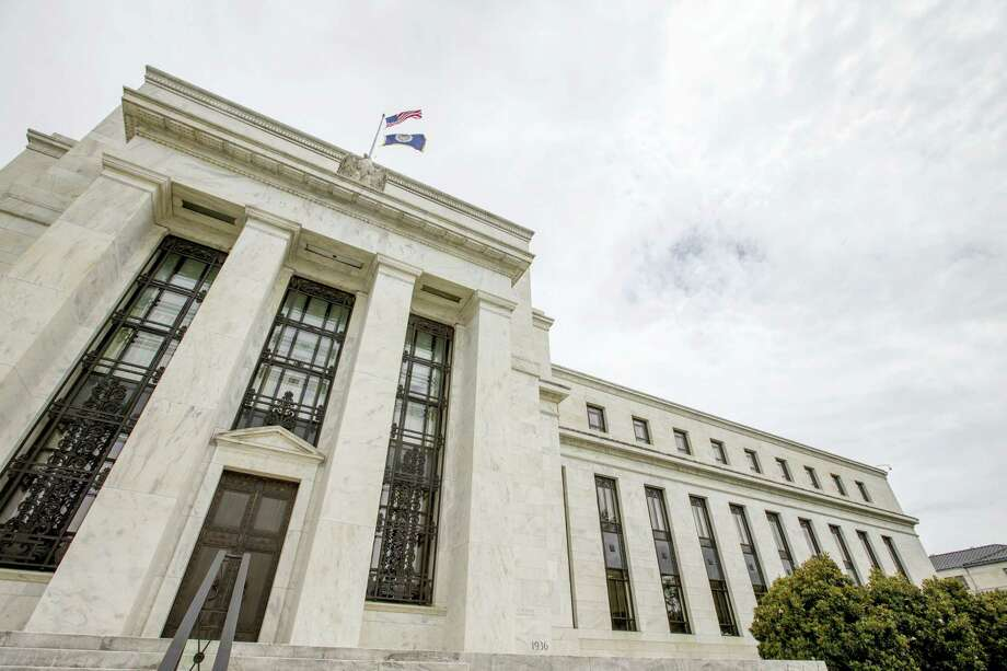 This June 19, 2015 photo shows the Marriner S. Eccles Federal Reserve Board Building in Washington. When the Federal Reserve ends its latest policy meeting on July 26, 2017, it may hint at two key questions: Might persistently low inflation lead the Fed to slow its interest-rate hikes? And when will it start to shrink its balance sheet, a process that will likely elevate long-term borrowing costs over time? Photo: AP Photo — Andrew Harnik, File  / Copyright 2016 The Associated Press. All rights reserved. This material may not be published, broadcast, rewritten or redistribu