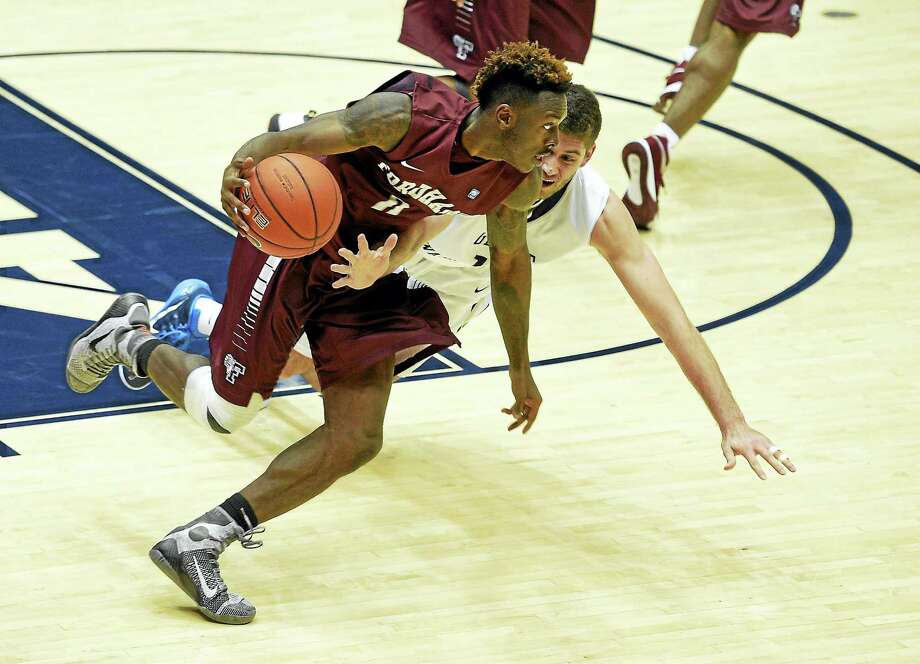 Fordham guard Antwoine Anderson, front, dribbles the ball against George Washington guard Patricio Garino. Anderson is expected to transfer as a grad student to UConn. Photo: File Photo - The Associated Press  / FR67404 AP