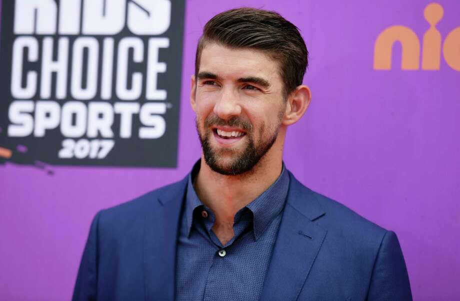 """In this July 13, 2017 photo, retired Olympic swimmer Michael Phelps arrives at the Kids' Choice Sports Awards at UCLA's Pauley Pavilion in Los Angeles. Discovery Channel's Shark Week's opening lineup Sunday, July 23, 2017 includes """"Phelps vs. Shark: Great Gold vs. Great White,"""" with Phelps testing his speed against that of a great white shark. Photo: Photo By Richard Shotwell/Invision/AP, File  / Invision"""