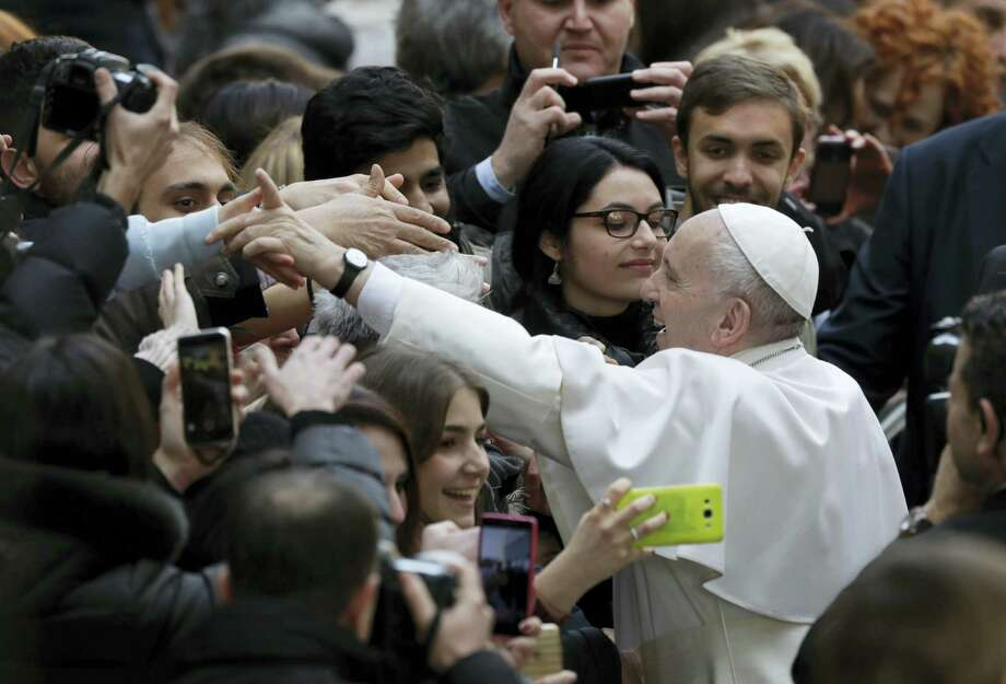 Pope Francis is greeted by the students of the Roma Tre University as he arrives for a visit in Rome on Feb. 17, 2017. Photo: AP Photo/Alessandra Tarantino  / Copyright 2017 The Associated Press. All rights reserved.