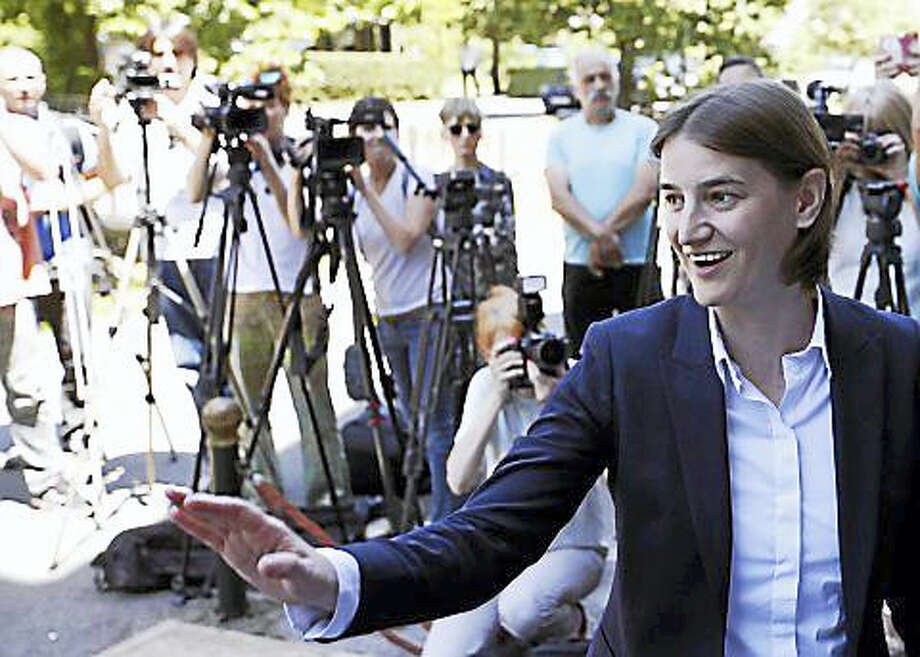 Darko Vojinovic/the Associated Press  Prime Minister-Designate Ana Brnabic arrives at the municipality building and waves to her supporters in Vrnjacka Banja, Serbia. Photo: Digital First Media