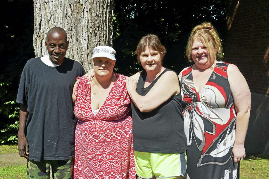 Shown, from left, are Chris James (Daniels' boyfriend), Carrie-Anne Daniels, her mother Carol Daniels and longtime friend Nadine Bailey. Carrie-Anne Daniels was diagnosed with two types of breast cancer earlier this year: ductal carcinoma in situ and HER2-positive. She has been unable to begin chemotherapy because her blood platelet levels are not high enough, although she has undergone a blood transfusion. Photo: Cassandra Day — Hearst Connecticut Media