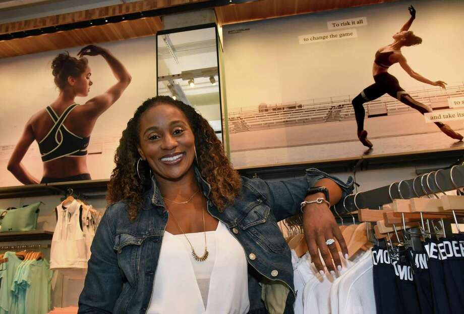 Adrienne Lofton, Senior Vice-president, Global Brand Management, at the Under Armour store in Harbor East on July 27, 2017. Behind her are images of dancer Misty Copeland from the newest ad campaign. Under Armour's recent campaigns for women include a pitch featuring stylized videos — set to poetry — showcasing the toughness and athleticism of ballerina Misty Copeland and other female athletes. Photo: Amy Davis /TNS / Baltimore Sun