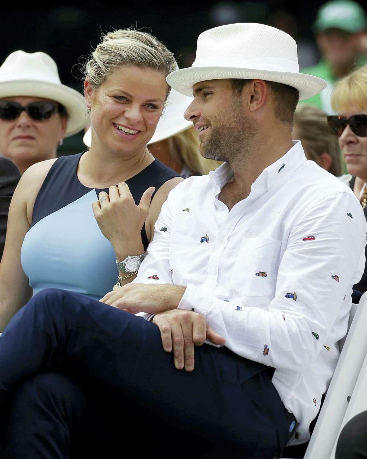 Tennis Hall of Fame inductees Kim Clijsters, left, and Andy Roddick chat during enshrinement ceremonies Saturday in Newport, R.I.