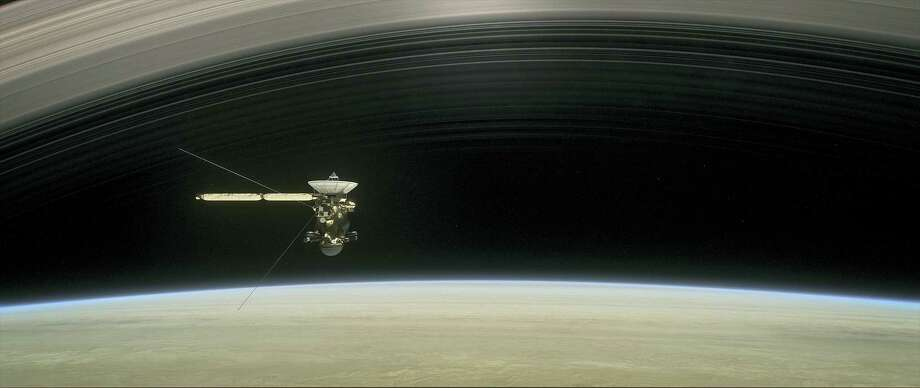 "This image made available by NASA in April 2017 shows a still from the short film ""Cassini's Grand Finale,"" with the spacecraft diving between Saturn and the planet's innermost ring. Launched in 1997, Cassini reached Saturn in 2004 and has been exploring it from orbit ever since. Cassini's fuel tank is almost empty, so NASA has opted for a risky, but science-rich grand finale. Photo: NASA/JPL-Caltech Via AP   / NASA/JPL-Caltech"