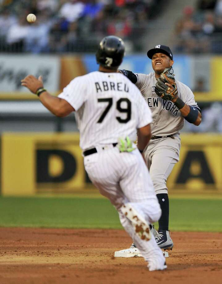 New York Yankees second baseman Starlin Castro throws to first base after forcing out Chicago White Sox's Jose Abreu at second base during the fourth inning of a baseball game, Monday, June 26, 2017, in Chicago. Photo: Paul Beaty - The Associated Press  / FR36811 AP