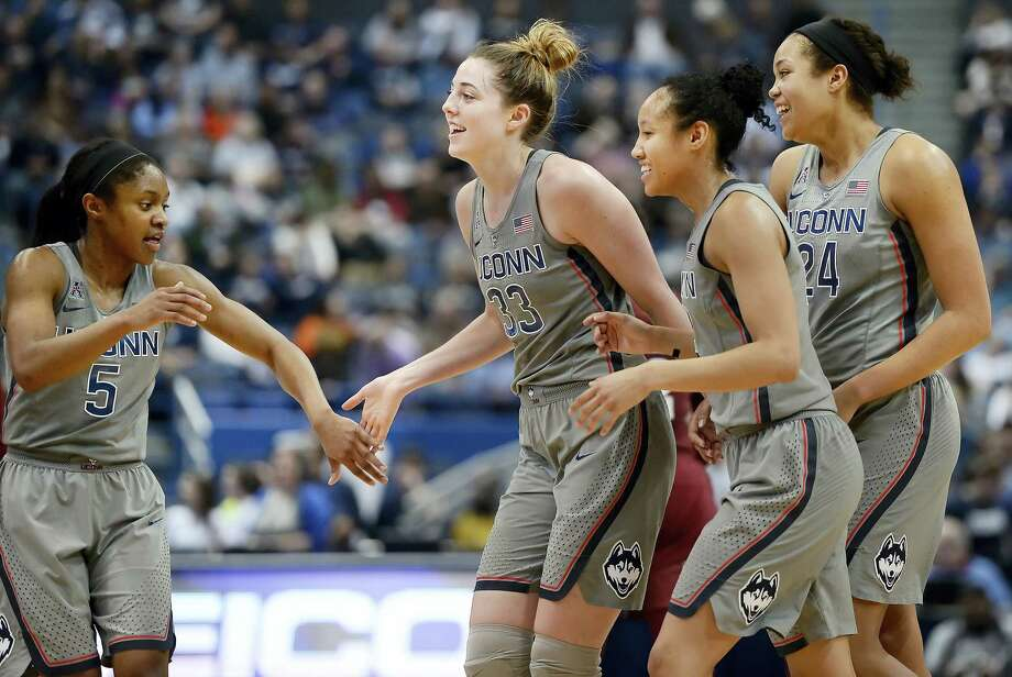 Connecticut's Crystal Dangerfield, Katie Lou Samuelson, Saniya Chong and Napheesa Collier, from left, celebrate as they come off the court for a timeout in the second half of an NCAA college basketball game against Temple, Wednesday in Hartford, Conn. Photo: Jessica Hill — The Associated Press  / AP2017