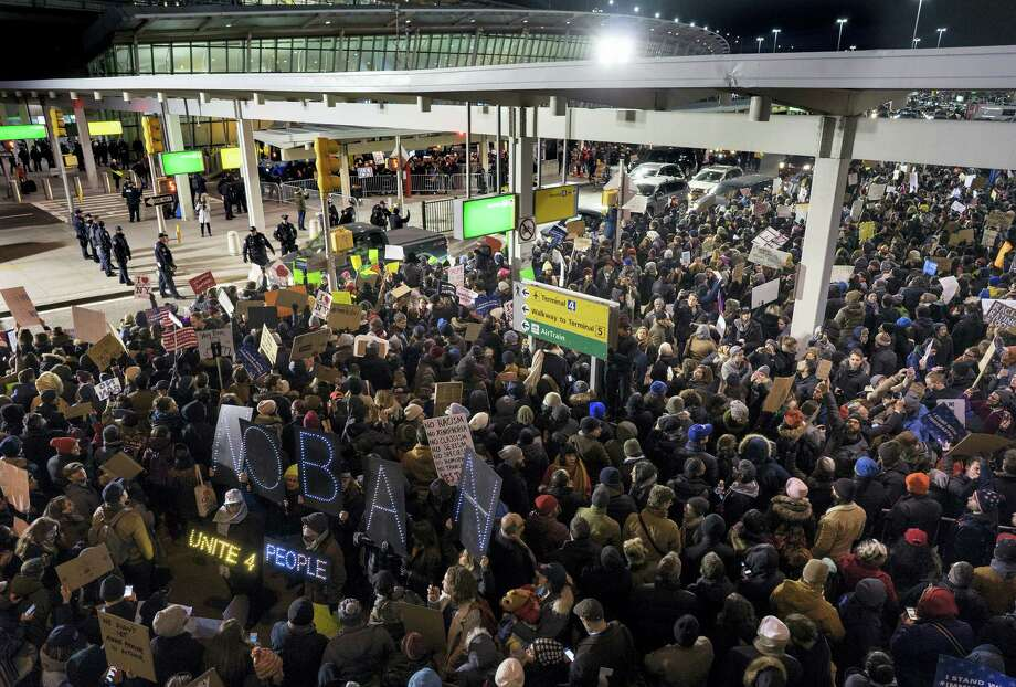 Protesters assemble at John F. Kennedy International Airport in New York, Saturday, Jan. 28, 2017 after earlier in the day two Iraqi refugees were detained while trying to enter the country. Photo: AP Photo/Craig Ruttle / FR61802 AP