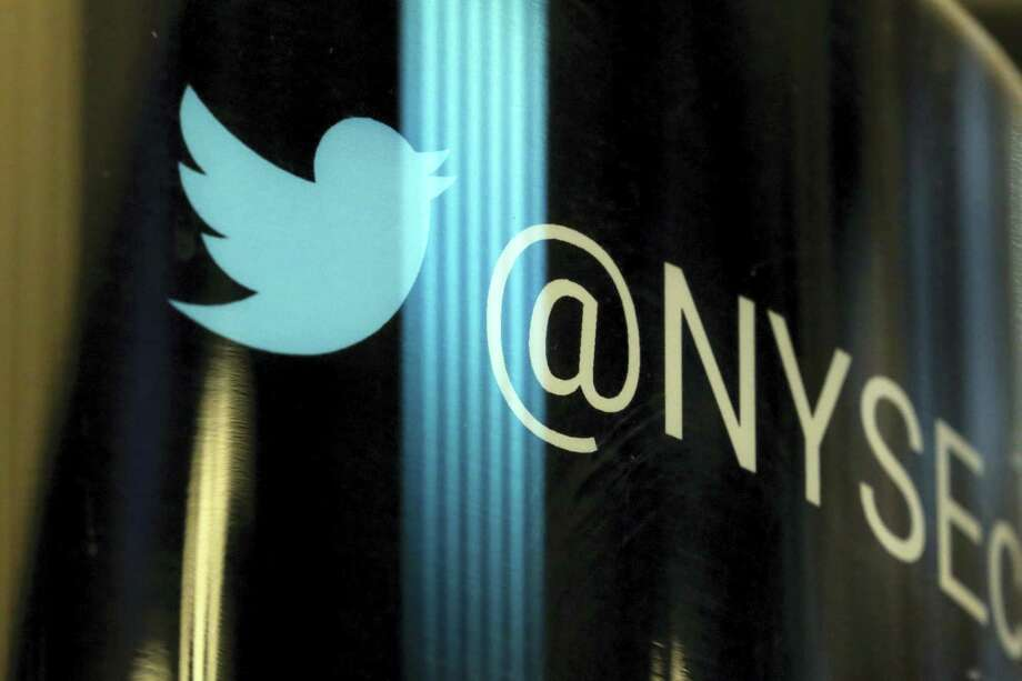 In this Thursday, Oct. 27, 2016 photo, the Twitter logo appears on a phone post on the floor of the New York Stock Exchange. Twitter's frequent presence in the news, as the preferred megaphone for President Donald Trump, has not translated into profit or meaningful user growth for the company. Twitter, Inc. reports earnings on Wednesday, April 26, 2017. Photo: AP Photo — Richard Drew, File  / AP