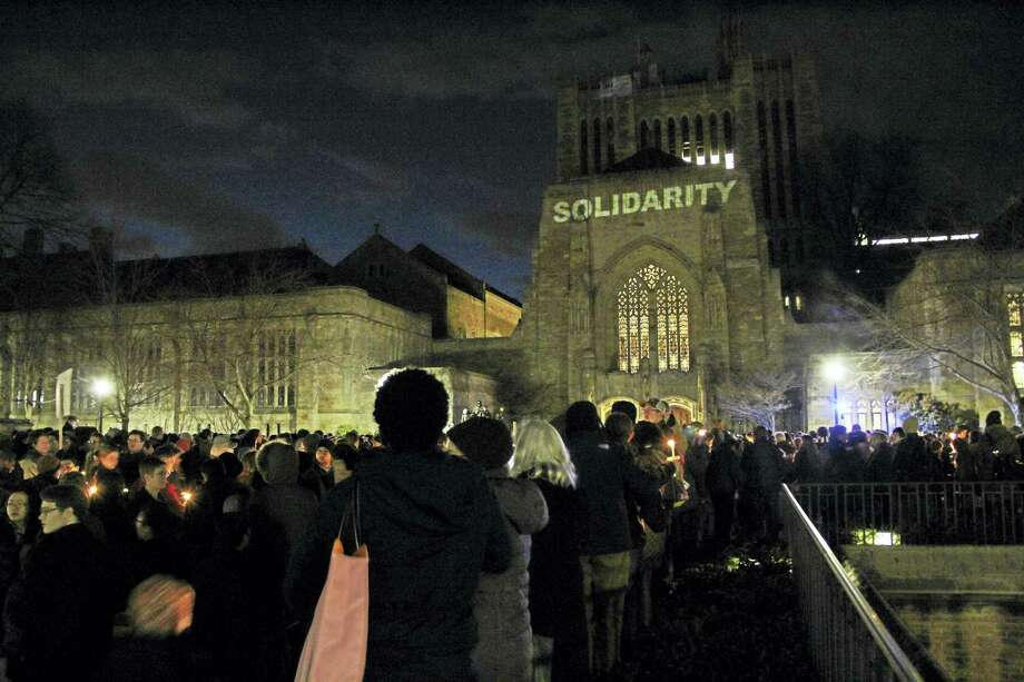 Yale University students and New Haven residents gathered for a candlelight vigil Sunday night in front of Sterling Memorial Library on College Street. Photo: Anna Bisaro — New Haven Register