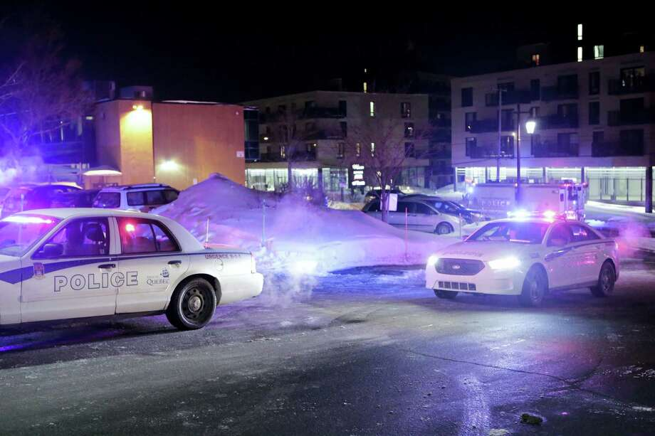 "Police survey the scene after deadly shooting at a mosque in Quebec City, Canada, Sunday, Jan. 29, 2017. Quebec Premier Philippe Couillard termed the act ""barbaric violence"" and expressed solidarity with victims' families. (Francis Vachon/The Canadian Press via AP) Photo: AP / The Canadian Press"