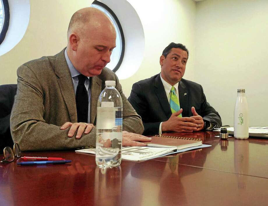 Connecticut Green Bank President and CEO Bryan Garcia, right, and Craig Connolly, Green Bank marketing director, left, speak to the Register editorial board. Photo: Helen Bennett — New Haven Register