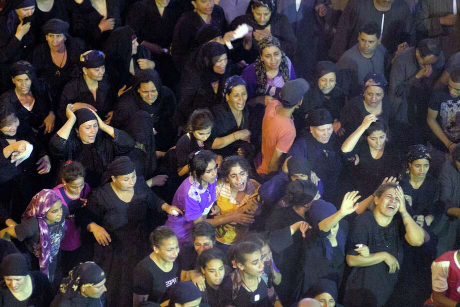 Relatives of Coptic Christians killed in a bus attack react during their funeral service at Abu Garnous Cathedral in Minya, Egypt, Friday, May 26, 2017. Egyptian security and medical officials say the death toll in the shooting by masked gunmen of a bus carrying Christians, many of them children, on their way to a remote desert monastery has risen to over 29. Photo: AP Photo/Amr Nabil   / Amr Nabil