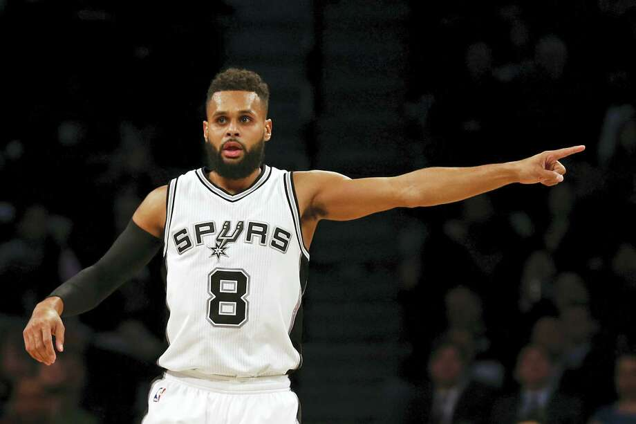 """In this Monday, Jan. 23, 2017 photo, San Antonio Spurs guard Patty Mills (8) gestures after making a three point basket during the second half of an NBA basketball game against the Brooklyn Nets, in New York. Teams, and the league, try to make the transition to the NBA easier for all players, but internationals need some special attention. """"You're in South Texas and it's very different from Australia,"""" Mills said. Photo: AP Photo/Adam Hunger, File  / FR110666 AP"""