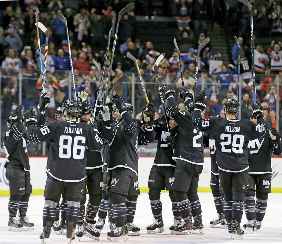 The New York Islanders celebrates after their 6-4 victory over the New Jersey Devils in an NHL hockey game on Feb. 19, 2017 in New York. Photo: AP Photo/Kathy Willens  / Copyright 2017 The Associated Press. All rights reserved.