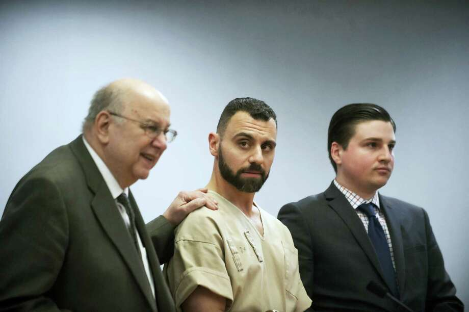 In this Monday, April 17, 2017 photo, Richard Dabate, center, appears with attorneys Hubie Santos, left, and Trent LaLima, right, while being arraigned, in Rockville Superior Court in Vernon, Conn. Authorities said Dabate told them a masked man had entered their home Dec. 23, 2015, shot his wife and tied him up before he burned the intruder with a torch. But the New York Daily News reported the Connecticut State Police wrote in an arrest warrant that his wife's Fitbit was logging steps after the time Dabate told them she was killed. Photo: Mark Mirko — Hartford Courant Via AP, Pool, File  / Pool Hartford Courant