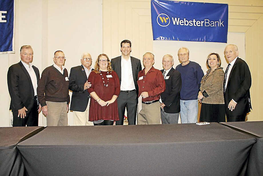 Los Angeles Dodgers Pitcher Rich Hill spoke at the Middlesex County Chamber of Commerce's January member breakfast meeting, where he received the 2017 Role Model of the Year Award. Larry Hill, Rich Hill's brother, who lives in Durham, appears on the left, along with longtime admirers of Rich Hill from the Middlesex YMCA, including Middlesex YMCA president Michele Rulnick and President of the Middlesex County Chamber of Commerce Larry McHugh. Photo: Contributed Photo