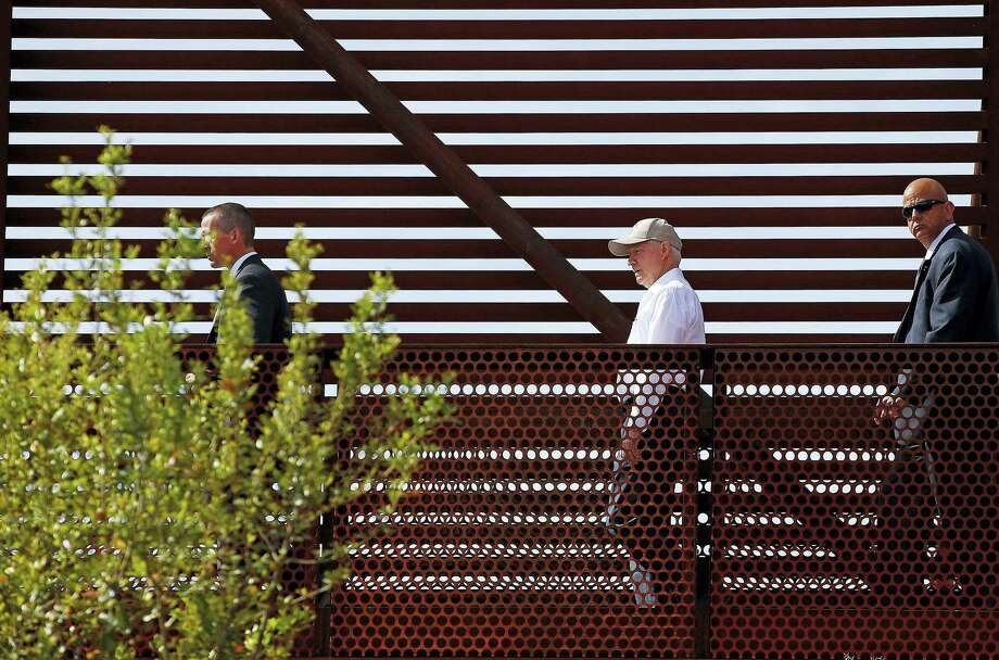 In this April 11, 2017 photo, Attorney General Jeff Sessions, center, tours the U.S.-Mexico border with border officials in Nogales, Ariz. Photo: AP Photo — Ross D. Franklin  / Copyright 2017 The Associated Press. All rights reserved.
