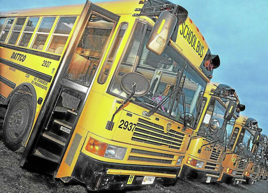 School buses lined up. Photo: Middletown Press File Photo  / TheMiddletownPress