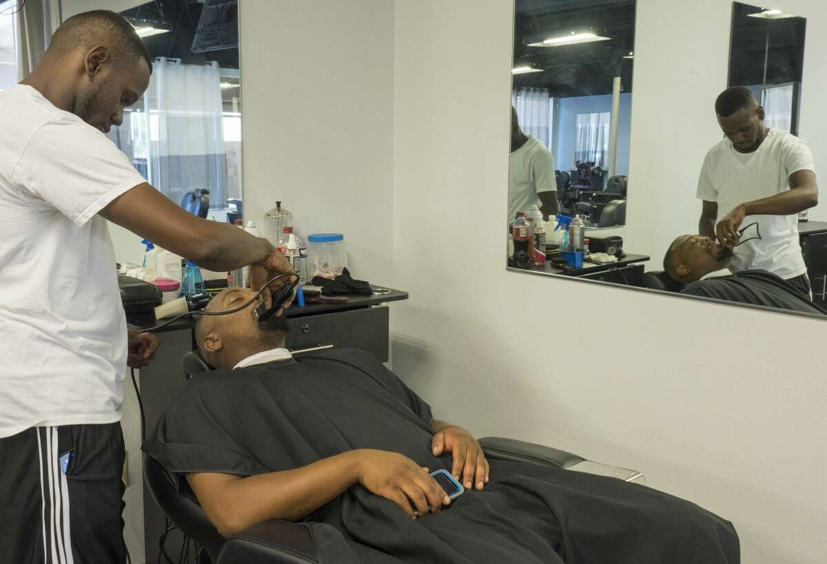 Skeet gives Chris a shave and cut 8/11/17 The King Cave Barbershop and Spa. Tim Fischer/Reporter-Telegram