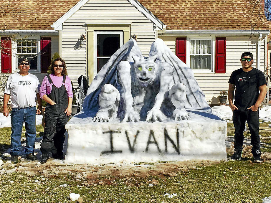 """Courtesy Karen Malave  Work on this year's snow sculpture by Will, Karen and Washington Malave at their 272 Fowler Ave. home  began a couple weeks ago after the Feb. 9 storm. """"We finally finished Ivan the gargoyle on Sunday before all the warm weather melted away all our work,"""" said Karen Malave.  Ivan, who stands 7 feet tall and 8 inches wide, was """"born"""" after at least 10 hours of work. """"Last year due to lack of snow, we weren't able to create anything.  So we were happy to get one in this year,"""" Malave said. """"We are already planning on what we will build next year!"""" Photo: Courtesy Karen Malave"""