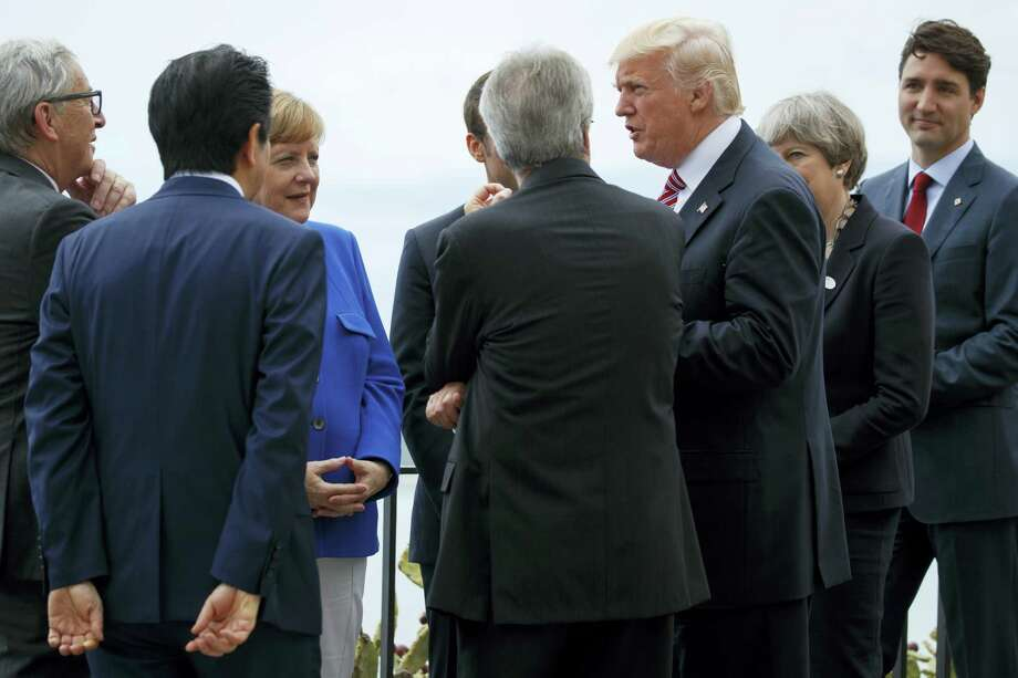 President Donald Trump poses for photos with G7 leaders at the Ancient Greek Theater of Taormina during the G7 Summit, Friday, May 26, 2017, in Taormina, Italy. Photo: AP Photo/Evan Vucci   / Copyright 2017 The Associated Press. All rights reserved.