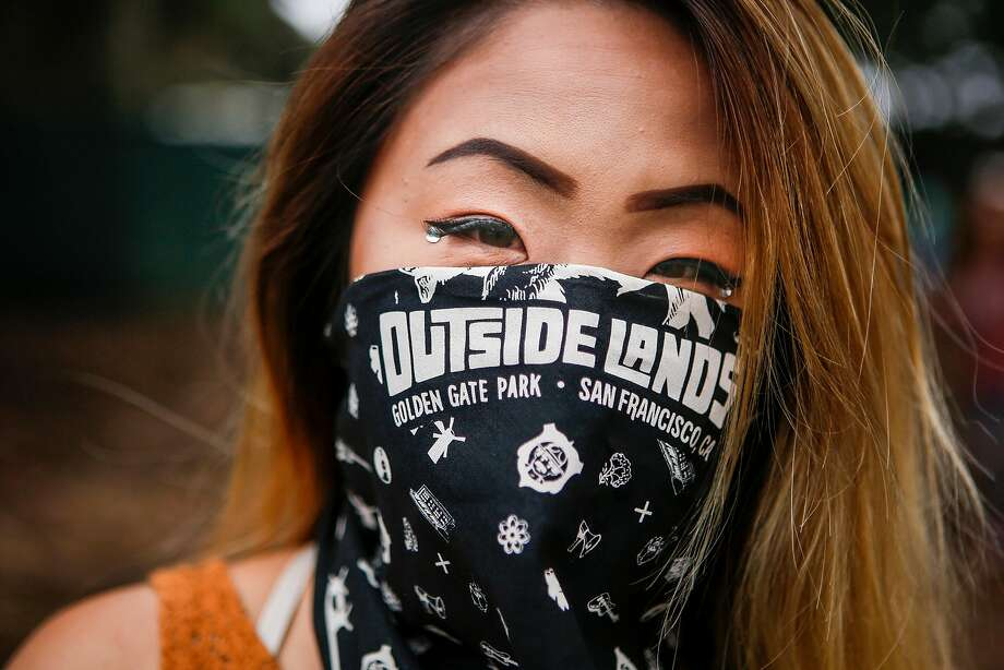 Trinh Du stands for a portrait wearing the bandana she bought from the march store during the 10th annual Outside Lands Festival in Golden Gate Park in San Francisco on Friday, August 11, 2017. Photo: Nicole Boliaux, The Chronicle