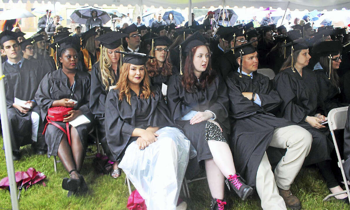 On a rainy Thursday night, 427 graduates and their families gathered under tents for Middlesex Community College's 50th annual commencement ceremony in Middletown.