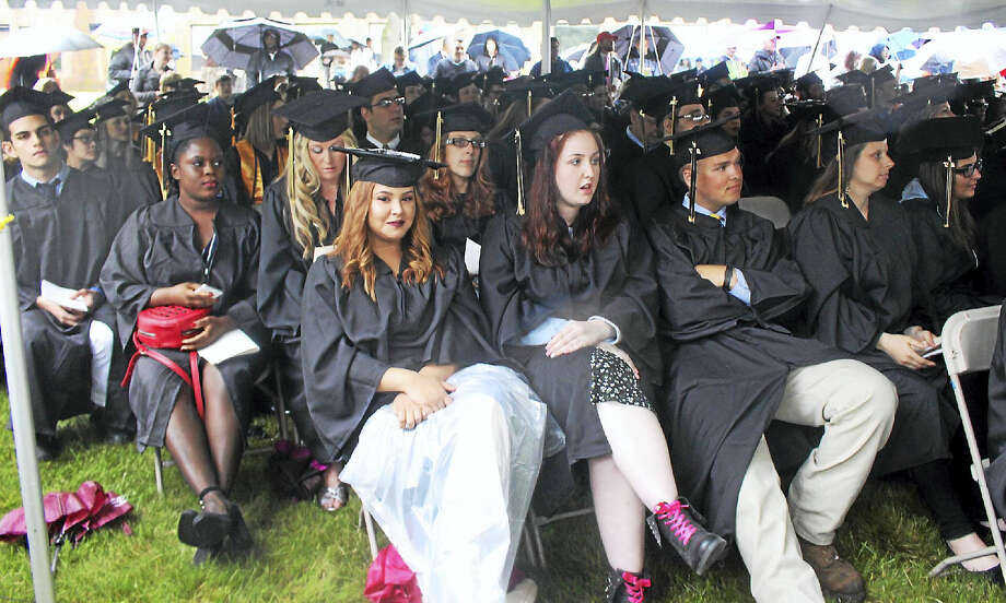 On a rainy Thursday night, 427 graduates and their families gathered under tents for Middlesex Community College's 50th annual commencement ceremony in Middletown. Photo: Analisa Novak — Special To The Press