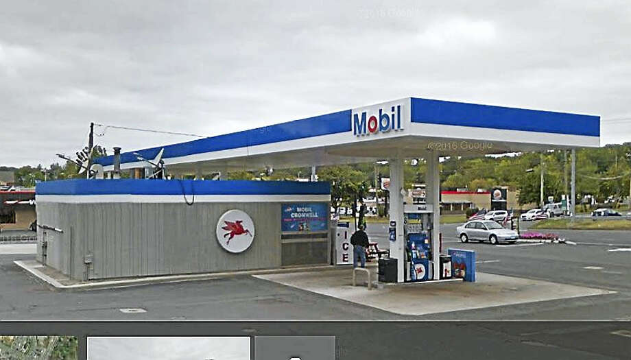The Mobile gas station at 123 Berlin Road was robbed early Friday morning, say Cromwell police, who are searching for a Hispanic male with long brown hair who stands about 5 feet 8 to 5 feet 10 inches tall. Photo: Google Earth
