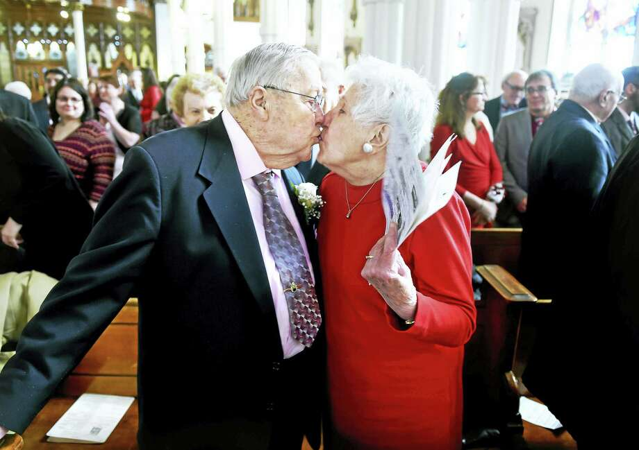 Daniel and Mariette Hogan kiss after renewing their vows during Mass at The Church of Assumption in Ansonia as World Marriage Day coincided with Valentine's Day on Feb. 14, 2016. Photo: Arnold Gold — New Haven Register