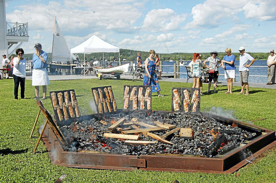 The 2017 Essex Annual Shad Bake will be held on Saturday, June 3, 3-6 p.m. at the Connecticut River Museum. For 59 years, the Rotary Club of Essex has been proudly holding this annual rite of spring, nailing delicious American shad onto oak planks and roasting them around a large bonfire.  Share this wonderful Connecticut tradition with your family and friends! Tickets are now available. The $30 adult (Shad or Chicken dinner option) and $10 child (12 and under) ticket includes the full meal and admission to the Museum.  Tickets will be an additional $5 on the day of the event. Beer, wine and soda will be available for purchase with a valid ID.  Freshly shucked clams and oysters will also be available at an additional price beginning at 3:00 pm. No carry-in alcohol will be permitted. Photo: Digital First Media