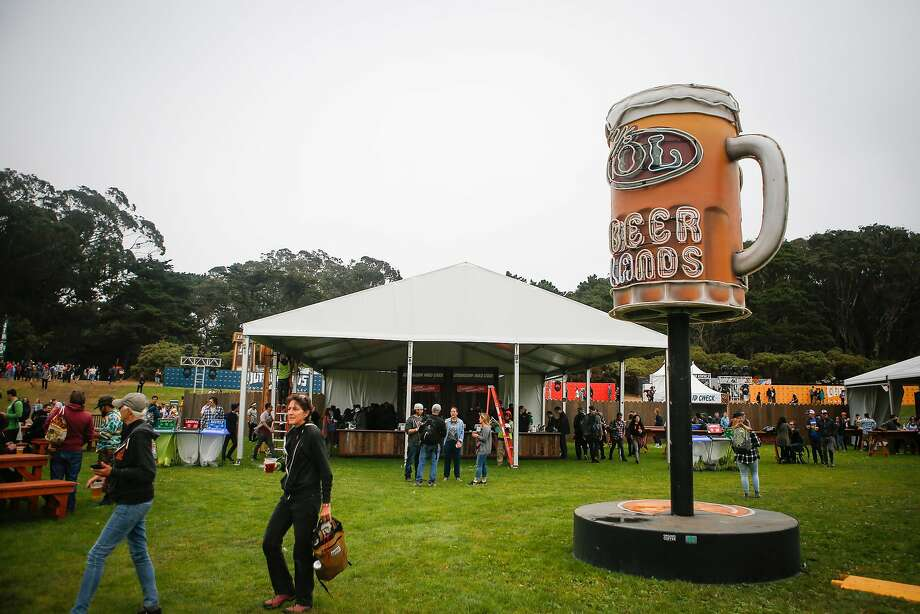 Festival goers buy pints of beer from Beer Lands during the 10th annual Outside Lands Festival in Golden Gate Park in San Francisco on Friday, August 11, 2017. Photo: Nicole Boliaux, The Chronicle