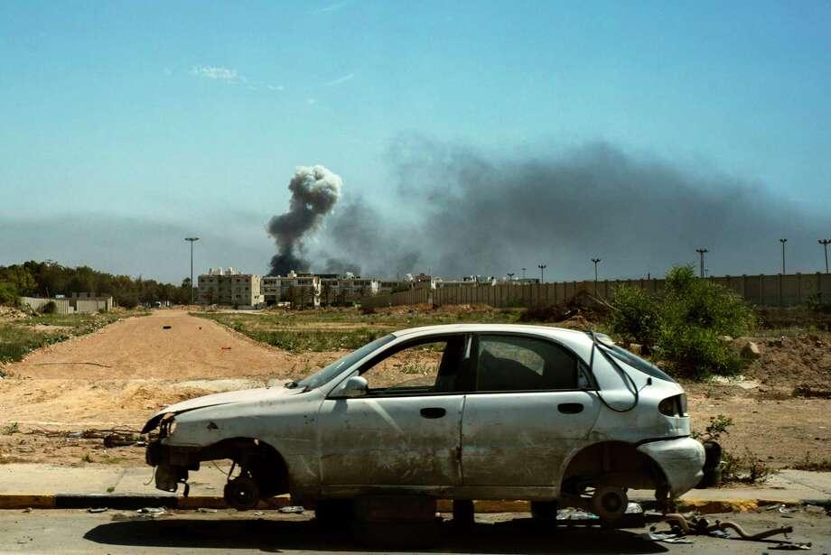 Smoke rises Friday after an explosion inTripoli, Libya. Photo: Photo By Lorenzo Tugnoli For The Washington Post.