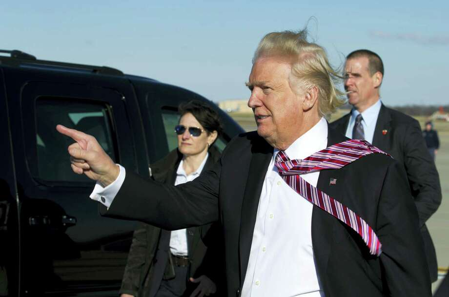 President Donald Trump points to guests upon his arrival at Andrews Air Force One, Md., on Thursday. Photo: Jose Luis Magana — AP Photo  / FR159526 AP