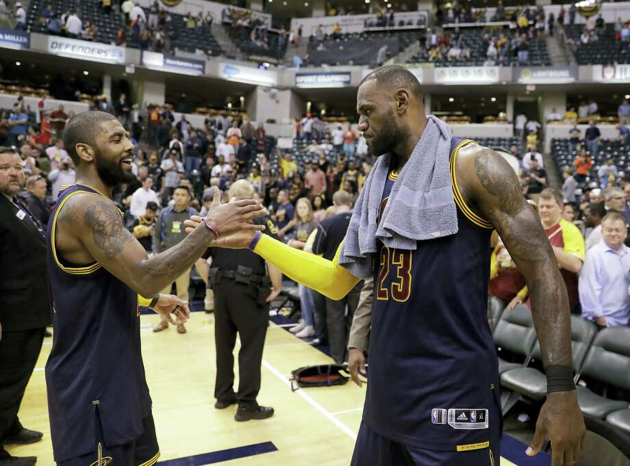 Cleveland Cavaliers' LeBron James, right, and Kyrie Irving celebrate after Cleveland defeated the Indiana Pacers 106-102 to win Game 4 of a first-round NBA basketball playoff series on April 23, 2017 in Indianapolis. Cleveland won the series 4-0. Photo: AP Photo — Darron Cummings  / Copyright 2017 The Associated Press. All rights reserved.