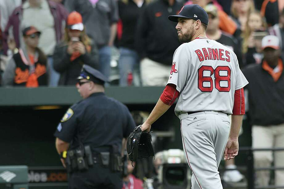 Red Sox pitcher Matt Barnes walks off the field after being ejected for throwing at Manny Machado on Sunday. Photo: Gail Burton — The Associated Press   / FR4095 AP