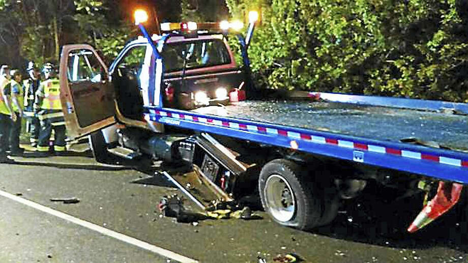 A photo from the June 2016 crash involving a AAA flat bed, SUV and a Lexus. Photo: Courtesy Of The Westport PD