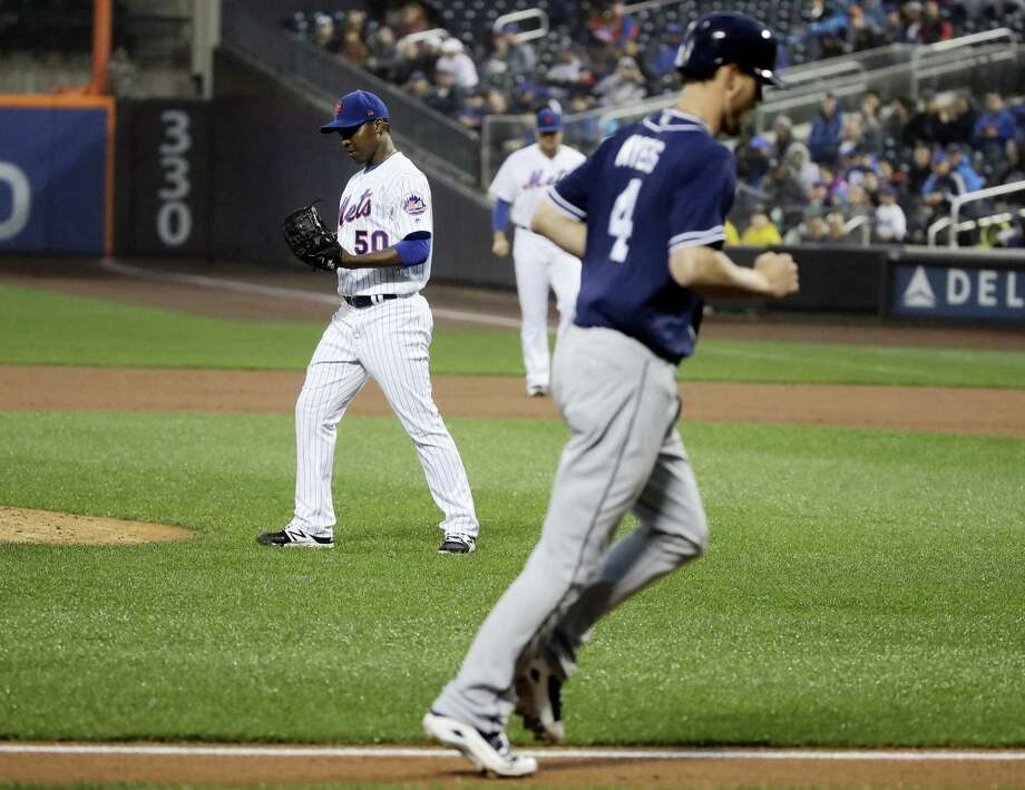 Mets pitcher Rafael Montero, left, reacts as the Padres' Wil Myers heads home on a bases loaded walk. Photo: Frank Franklin II — The Associated Press  / Copyright 2017 The Associated Press. All rights reserved.