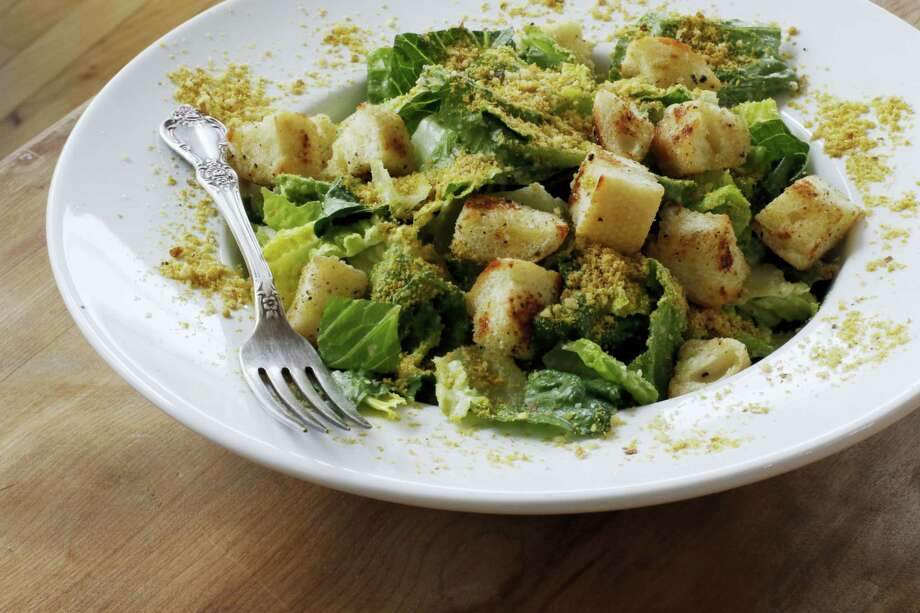 A vegan Caesar salad with Japanese miso paste and nutritional yeast flakes. (AP Photo — J.M. Hirsch) Photo: AP / AP