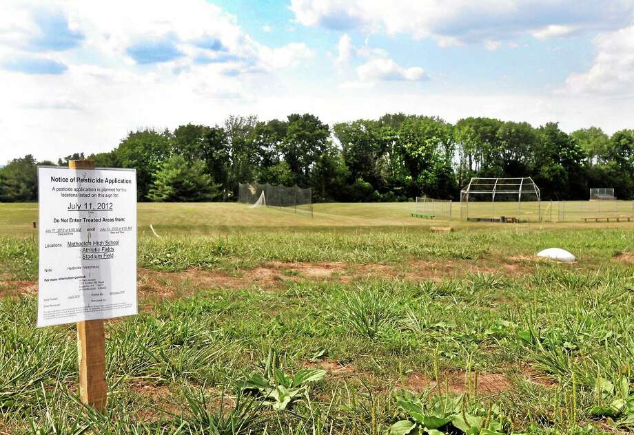 A notice of pesticide application sits outside a high school football stadium. The Jonah Center hopes Middletown residents will support a petition to ban pesticide use. Photo: File Photo